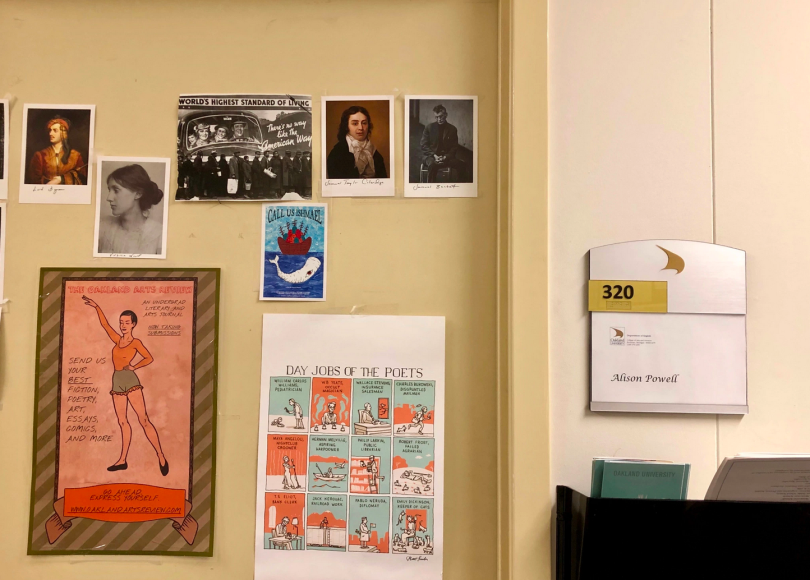 Pictures and posters on an office door, next to name card for office that reads Alison Powell.