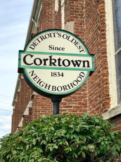 "Close-up view of street sign that reads ""Detroit's oldest neighborhood, Corktown, Since 1834"""