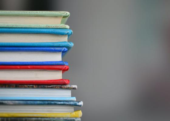 Stack of books of different colored hard covers