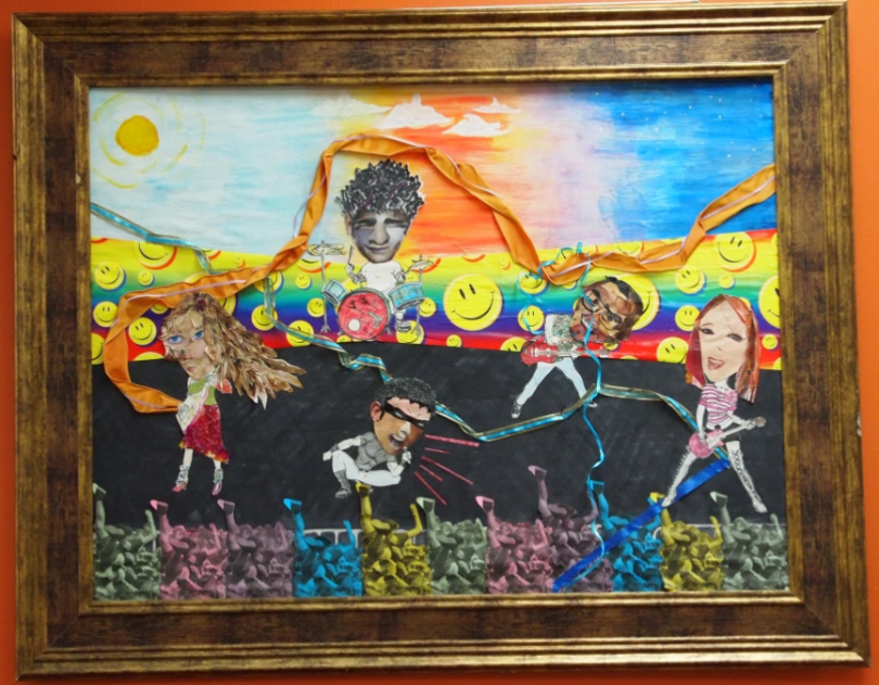 Colorful framed art of people connected by threads.
