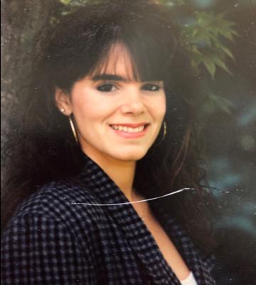 Smiling woman, long black hair
