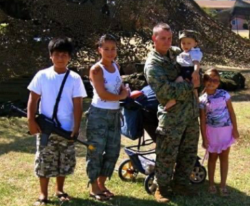 Family of five, with three children teen age and younger, husband wearing military marines uniform